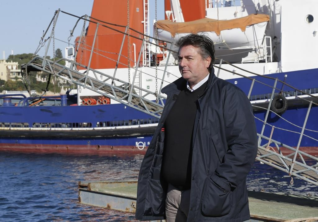 Giuseppe Barretta stands in the Brindisi port, southern Italy, Thursday.  (AP Photo/Antonio Calanni)