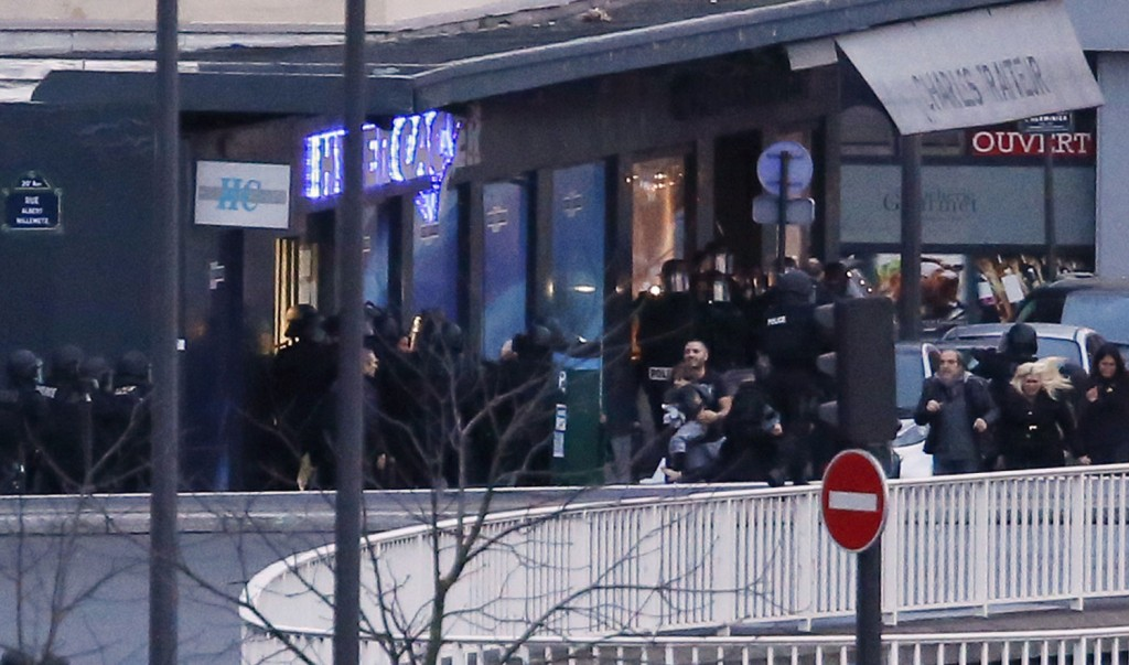 French Elite Police storm the Kosher Supermarket in Vincennes where hostages were held, killing the terrorist and ending the standoff. Several hostages have been freed; four were killed.