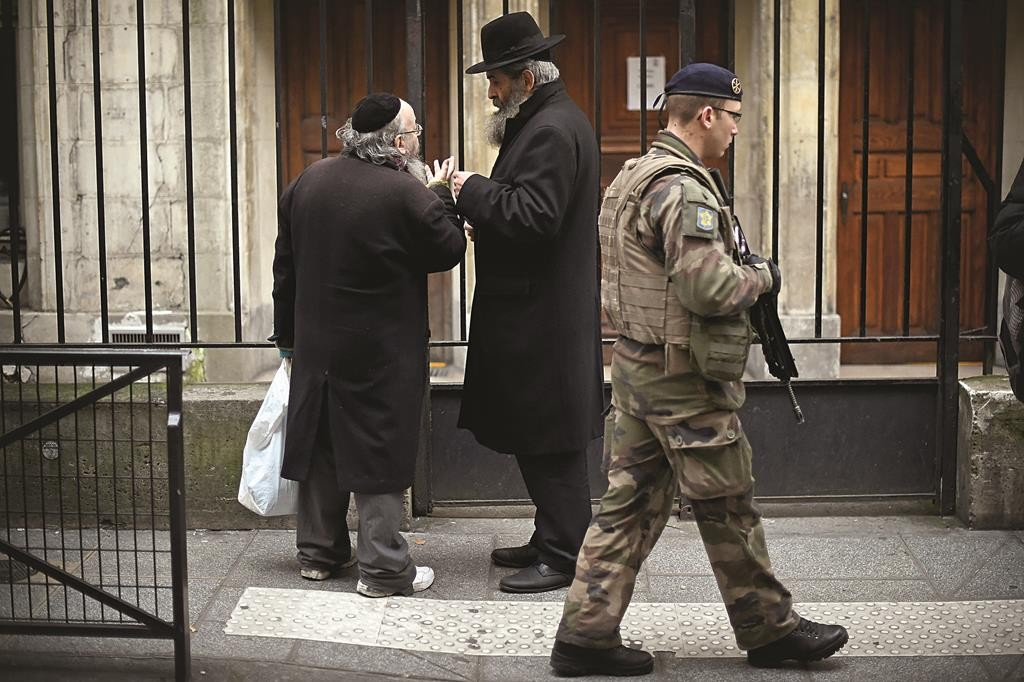 Armed security patrol outside a Jewish school in the Marais district on Monday, January 12, in Paris. (Jeff J Mitchell/Getty Image)