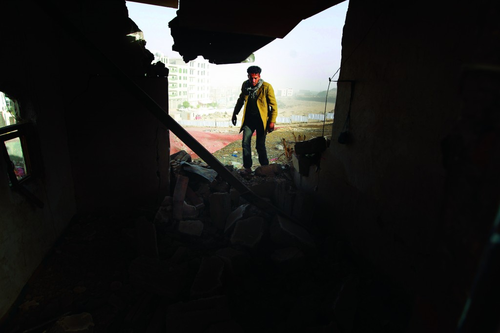 A Yemeni man walks amid the debris inside a heavily damaged house near the presidential palace in Sanaa on January 20, 2015, following fierce clashes between Huthi militiamen and the presidential guard the previous day. Witnesses said the fighting erupted early on January 19 after the Shiite militia, which controls the Yemeni capital, set up a new checkpoint near the presidential palace. The Huthis appear to be tightening their grip on Sanaa after abducting an aide to President Abdrabuh Mansur Hadi last week, in the biggest challenge yet to his rule. (Mohammed Huwais/AFP/Getty Images)