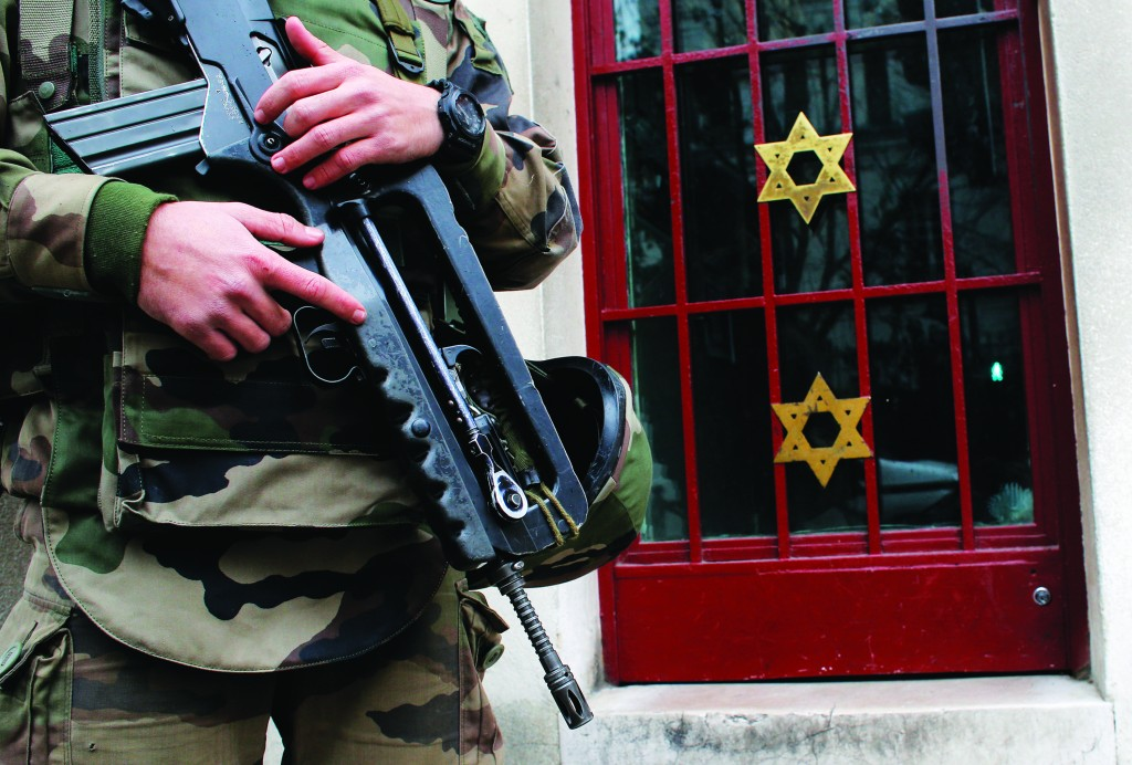 A soldier stands guard outside a shul in Neuilly sur Seine, France, Tuesday, Jan. 13, 2015.  (AP Photo/Christophe Ena)