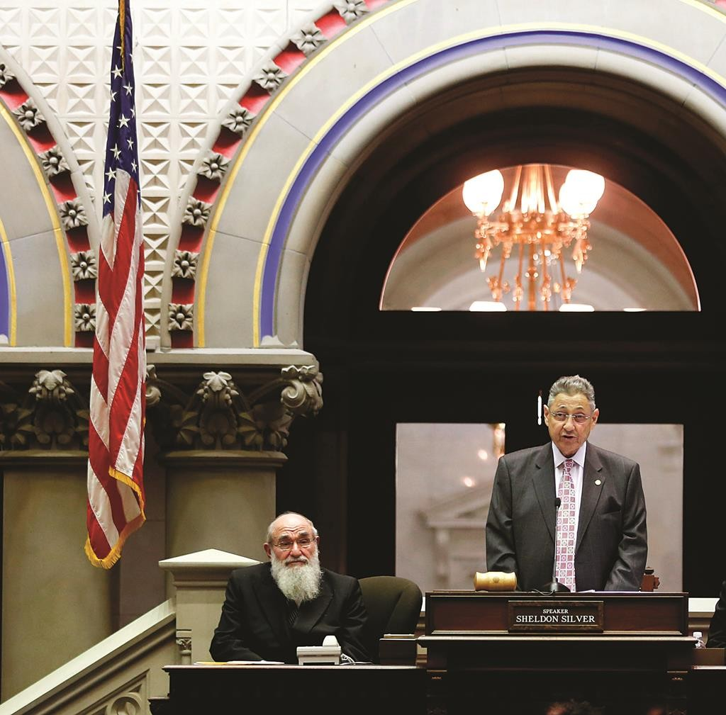 Assembly Speaker Sheldon Silver on Wednesday talks in the Chamber at the start of the 2015 legislative session. To his left is Harav Reuven Feinstein, Rosh Yeshivah of Yeshivah of Staten Island, who came to deliver the opening benediction. (AP Photo/Mike Groll)