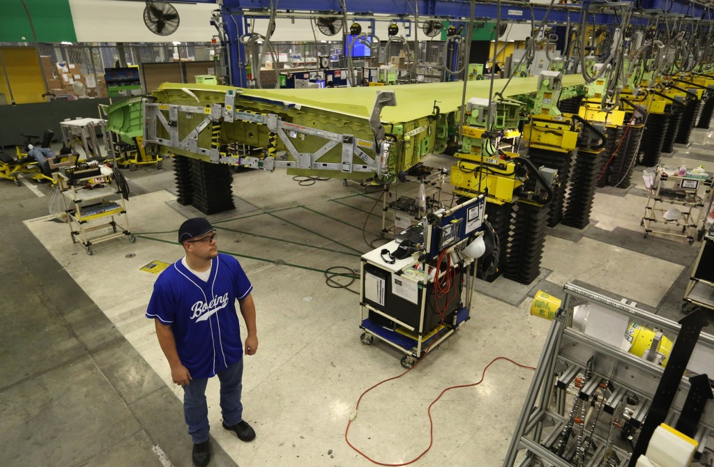 Gary Laws, a team-lead mechanic who works at Boeing's 737 wing-assembly facility in Renton, Wash., says an automated fastener machine has transformed his job. (Ken Lambert/Seattle Times/TNS)