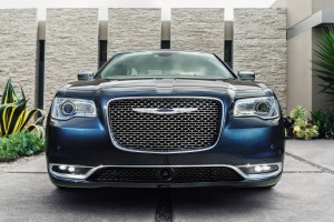 """The new, bolder """"face of Chrysler"""" mesh grille, sitting in the more-sculpted front fascia, is one-third larger, and the Chrylser wing has moved down toward the center of the grille. (A. J. Mueller/Chrysler)"""