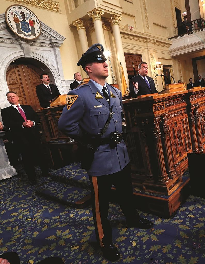 A State Police officer stands Tuesday as NJ Gov. Chris Christie delivers his State of the State. (AP Photo/Julio Cortez)