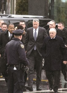 NYPD Commissioner Bill Bratton and Mayor Bill de Blasio on Saturday arrive at the wake at the Aievoli Funeral Home in Sunset Park.
