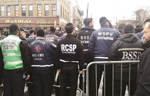 Representatives of Shomrim, Hatzolah and other emergency volunteer responders line 65th Street to pay respects to the NYPD.