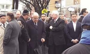 Sen. Simcha Felder talks with former New York Mayor Rudy Giuliani while waiting for the funeral procession. On the left is Councilman David Greenfield; to Giuliani's right is Sen. Marty Golden, Assembly Speaker Sheldon Silver, and former City Comptroller John Liu.