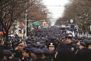 Sea of Blue: Tens of thousands of law-enforcement officials from across the country line the streets before the funeral of Officer Wenjian Liu.