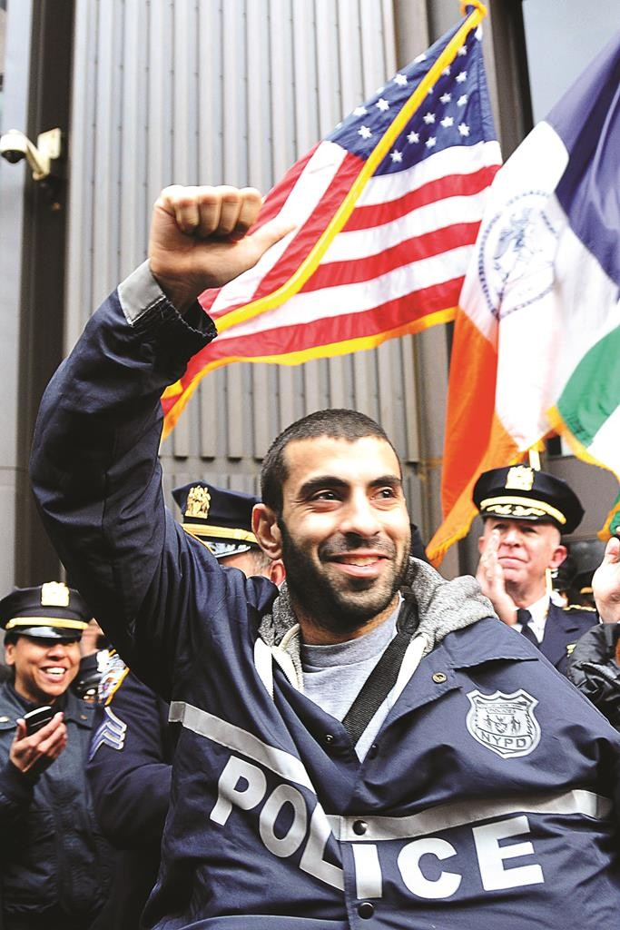 celebrates Friday after being released from the hospital. (AP Photo/NYPD Officer Andrew Dossi)