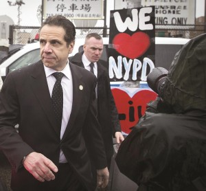 Gov. Andrew Cuomo on Saturday leaves the wake of Officer Wenjian Liu.