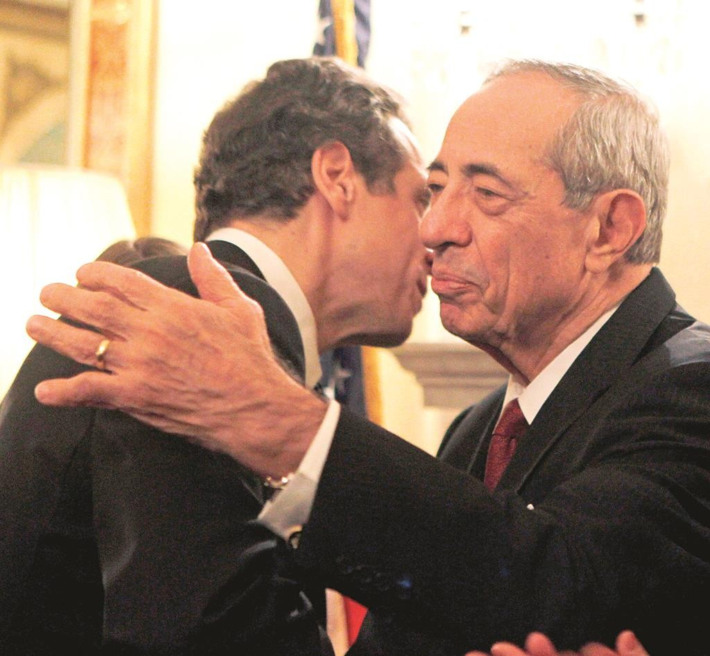 Mario Cuomo congratulates his son Andrew, (L), at the latter's swearing in on Dec. 31, 2010. (AP Photo/Mike Groll)