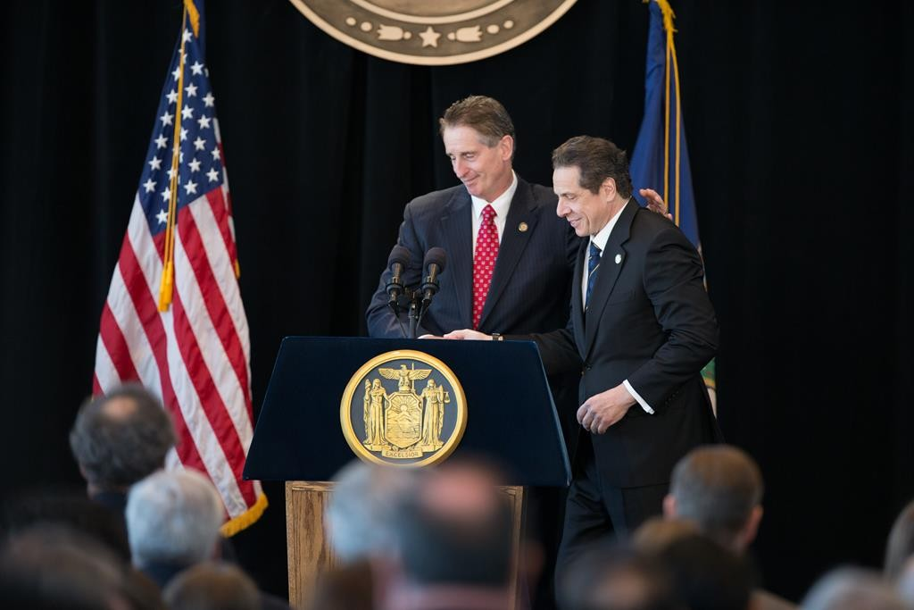 Outgoing New York Lt. Gov. Robert Duffy on Thursday escorts Gov. Andrew Cuomo at his inaugural ceremony at One World Trade Center. (Office of the governor)