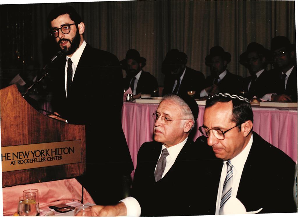Gov. Mario Cuomo with Rabbi Moshe Sherer at Agudath Israel's Dinner in 1986. Current Executive Vice President Rabbi Chaim Dovid Zwiebel is at the podium. (Agudath Israel/Sender Schwartz)