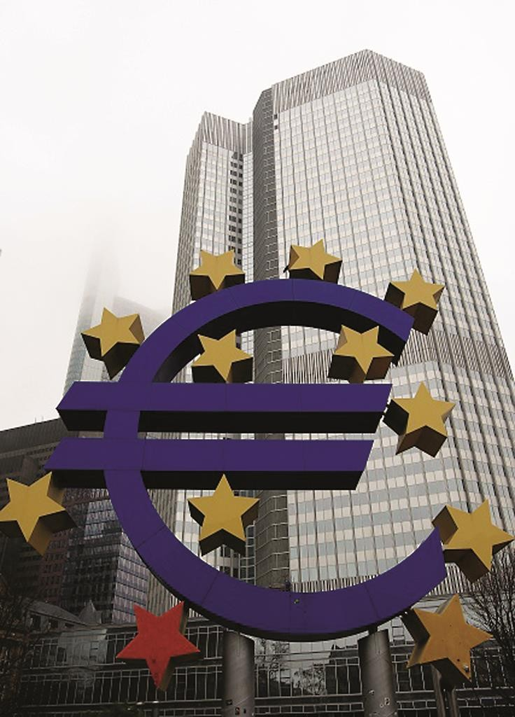 The euro sign sculpture is pictured in front of the building that used to host the headquarters of the European Central Bank ( ECB ) in Frankfurt am Main, western Germany, on January 26, 2015, a day after the results of the general elections in Greece, won by the radical leftist Syriza party. Its 40-year-old leader Alexis Tsipras has vowed to end austerity policies and renegotiate the country's debt, putting him on a collision course with other European leaders, particularly German Chancellor Angela Merkel. AFP PHOTO / DANIEL ROLAND (Photo credit should read DANIEL ROLAND/AFP/Getty Images)