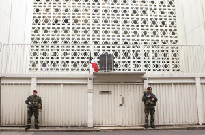 Soldiers stand guard outside a synagogue in Paris, Monday. (AP Photo/Jacques Brinon)