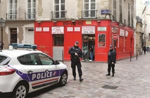 Police officers patrol Rue des Rosiers street, in the heart of the Paris Jewish quarter, Monday. (AP Photo/Remy de la Mauviniere)