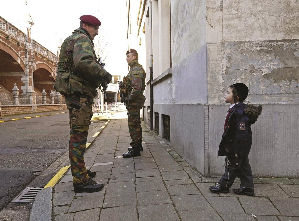 Belgian paratroopers guard outside a Jewish school in the central city of Antwerp. (REUTERS/Yves Herman)