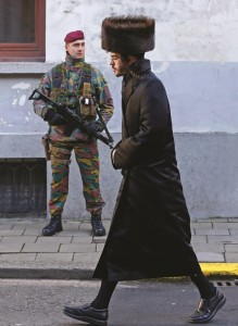 A Belgian paratrooper keeps guard outside a Jewish school in the central city of Antwerp. (REUTERS/Yves Herman)