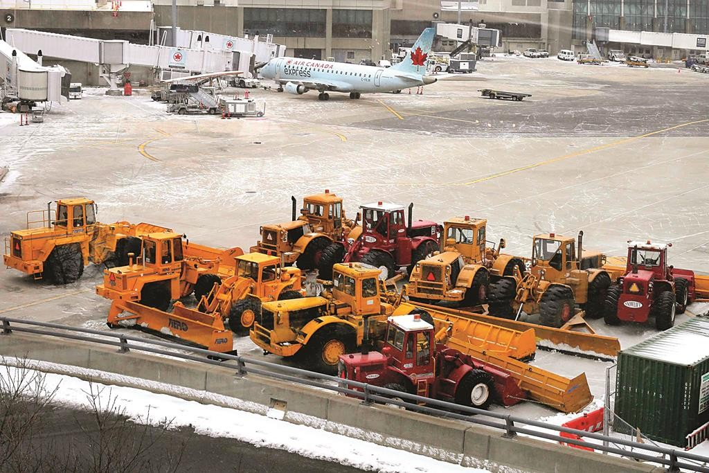 Snow-removal equipment sits on the tarmac at Logan Airport in Boston, Massachusetts, Monday. (REUTERS/Brian Snyder)