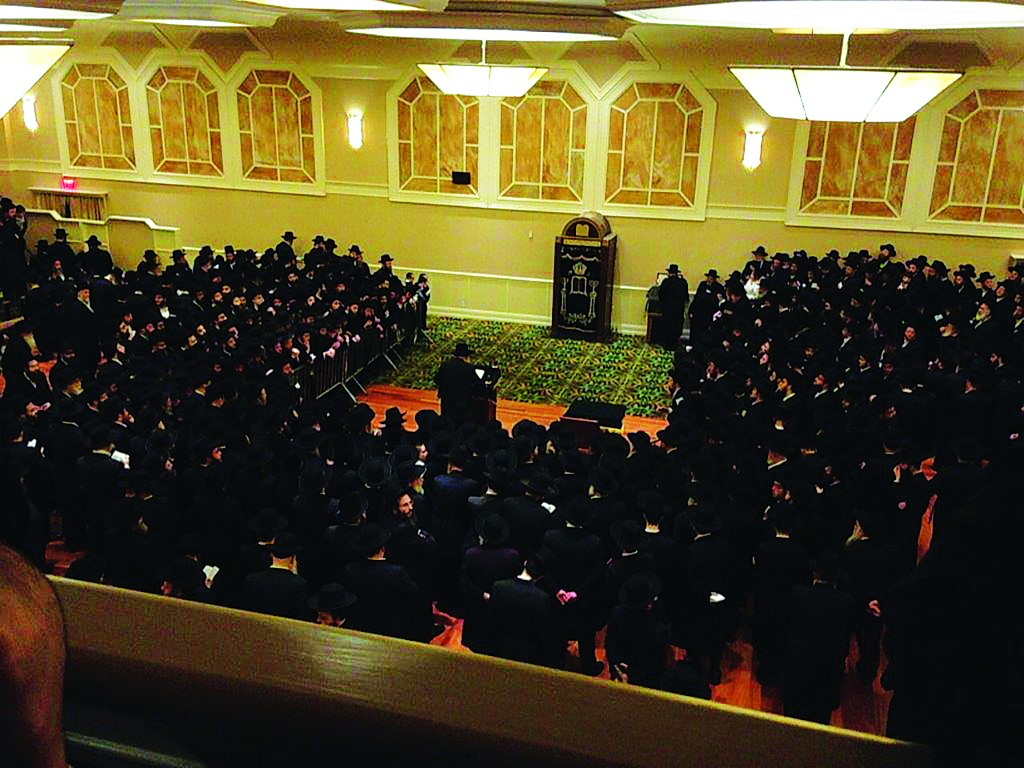 The Gerrer Rebbe, shlita, on a visit to New York, davens Minchah at The Palace in Boro Park, this week.