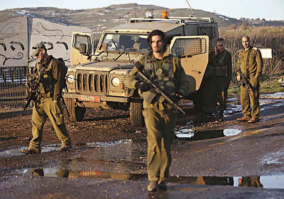 Israeli troops patrol the Golan Heights on Sunday. (JALAA MAREY/AFP/Getty Images)