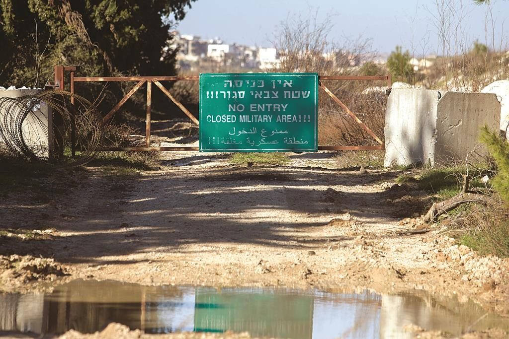"A sign reading ""No Entry - Closed Military Area,"" seen on the border between Israel and Lebanon, Wednesday. (Basal Awidat/Flash90)"