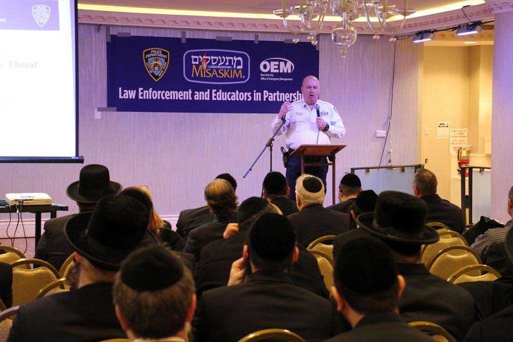 NYPD counterterrorism official Philip Van Gostein on Thursday addresses yeshivah administrators at a Misaskim event in Boro Park. (Misaskim/Hillel Engel)