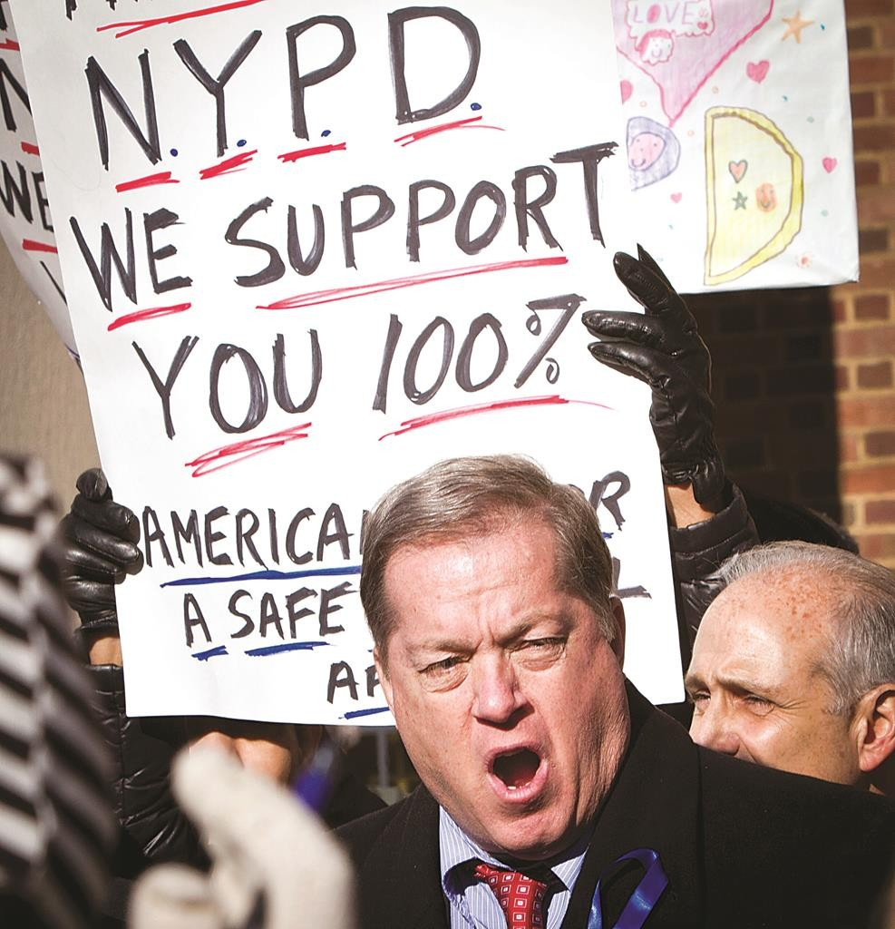 Retired NYPD Captain Joe Concannon speaks Tuesday during a pro-police rally outside Queens Borough Hall. (AP Photo/Bebeto Matthews)