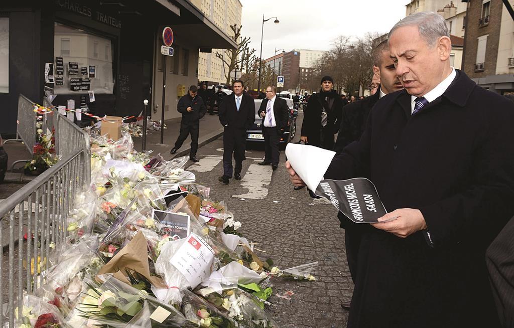 Israeli Prime Minister Binyamin Netanyahu outside the Hyper Cacher kosher market in Paris on Monday. (Haim Zach / GPO)