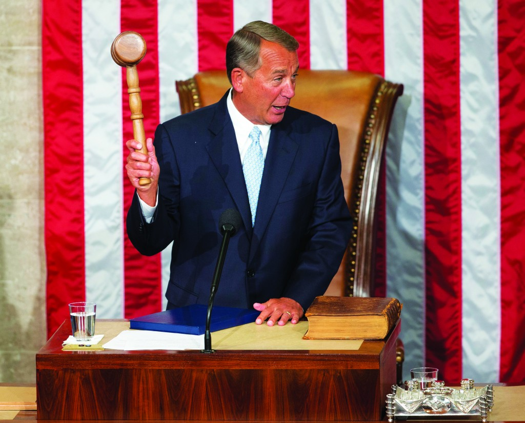 House Speaker John Boehner of Ohio holds up the gavel after being re-elected to a third term during the opening session of the 114th Congress, as Republicans assume full control for the first time in eight years, Tuesday, Jan. 6, 2015, on Capitol Hill in Washington. (AP Photo/Pablo Martinez Monsivais)