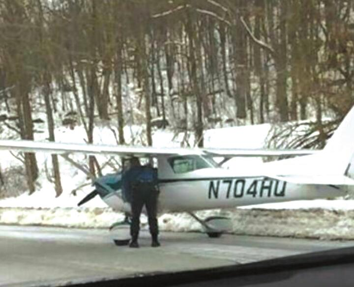 A small aircraft lands on Route 23 in New Jersey.