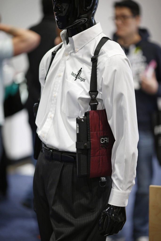 The TechSling smart device holster is displayed at the Tech Slinger booth during the International CES in Las Vegas. (AP Photo/John Locher)