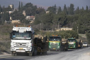 Trucks carrying armored vehicles seen near Israel's border with Lebanon on Tuesday. (REUTERS/Baz Ratner)