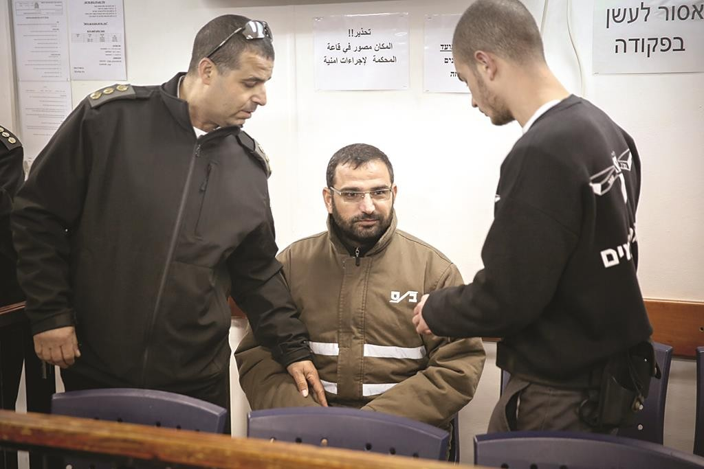 "Hussam Kawasmeh (C) in the Ofer prison courtroom where he was given three life sentences on Tuesday for the murders of three Israeli teens, Hy""d. (Miriam Alster/Flash90)"