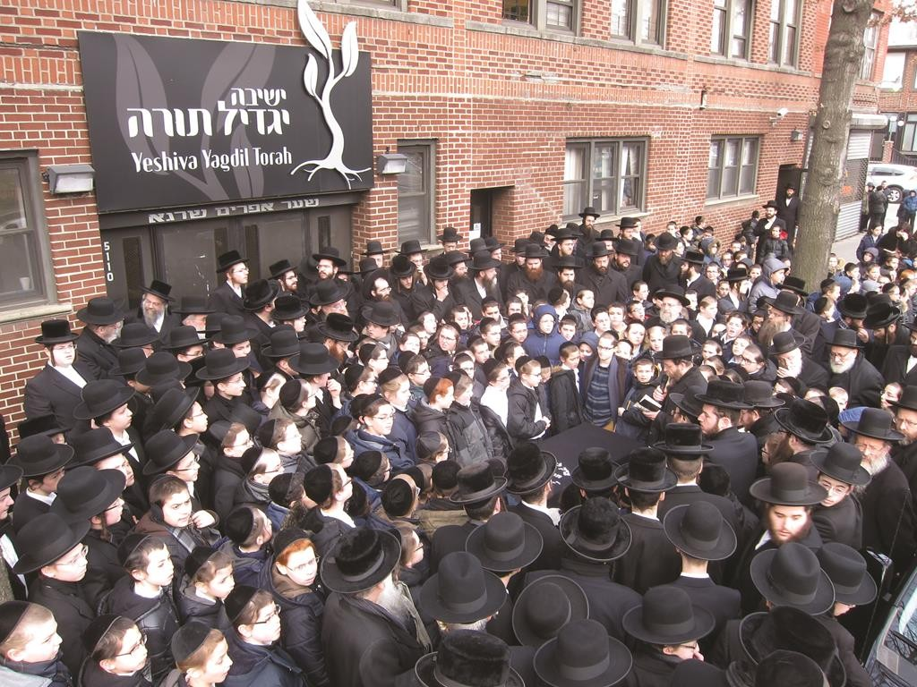 """A partial view of the crowd at the levayah of Mrs. Rivka Hendel Silberberg, a""""h, outside Yeshivah Yagdil Torah."""