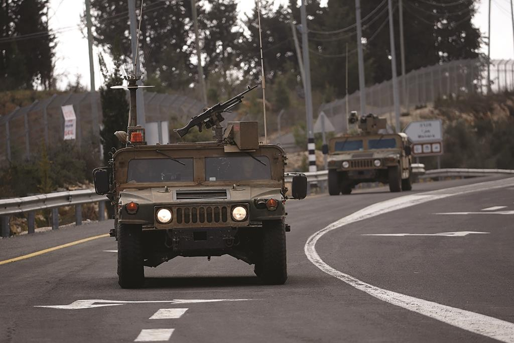Israeli army armored vehicles drive near Israel's border with Lebanon. (REUTERS/Baz Ratner)