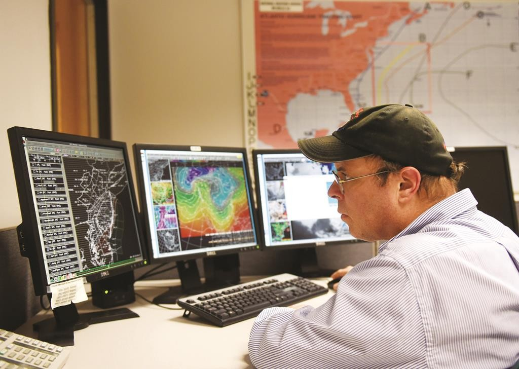 Meteorologist Anthony Gigi works on the weather report Tuesday at the National Weather Service control room in Mt. Holly, NJ. (AP Photo/Northjersey.com, Tyson Trish)