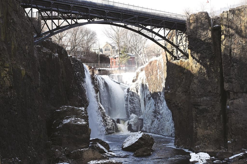 Ice starts to form Wednesday at Great Falls in Paterson, N.J., as wind-chill temperatures plunged near zero degrees. (AP Photo/The Record, Tyson Trish)