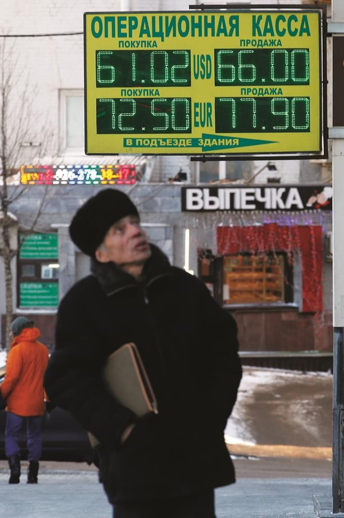 A board shows currency exchange rates on a street in Moscow, Tuesday.  (REUTERS/Maxim Zmeyev)