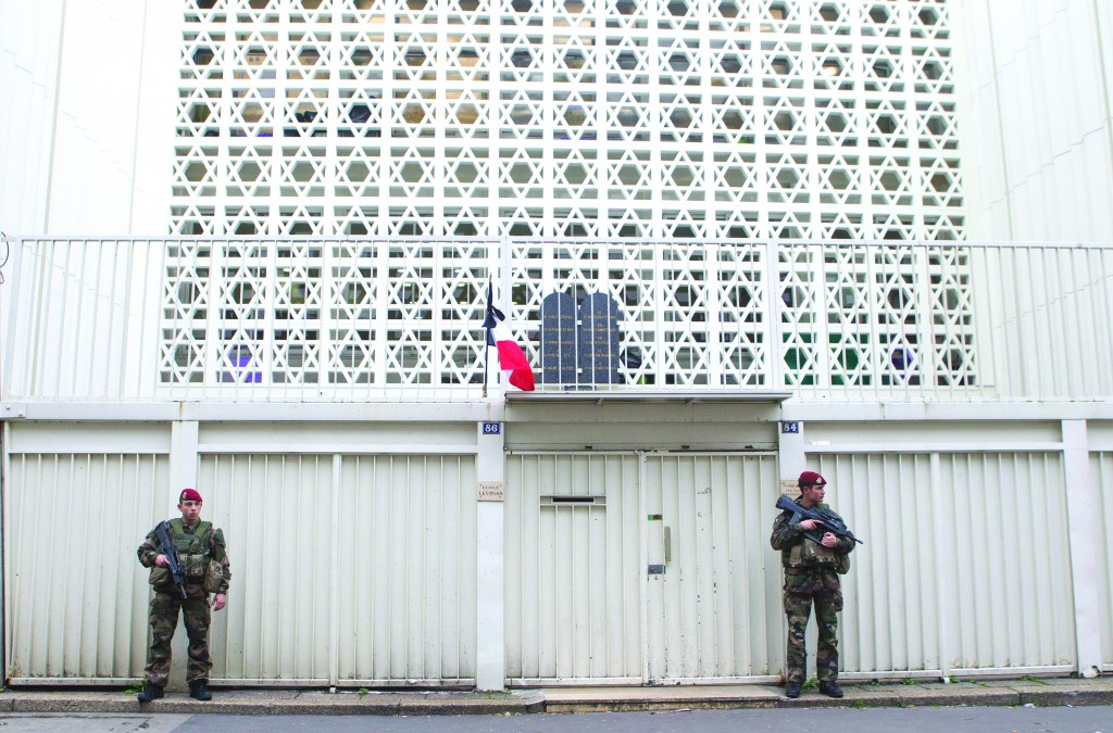 Soldiers stand guard outside a shul in Paris, Monday, Jan. 12, 2015.  (AP Photo/Jacques Brinon)