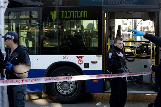 Israeli police officers at the scene of a terror attack in Tel Aviv on Wednesday. A Palestinian man stabbed as many as 13 people, injuring several seriously, on a bus in central Tel Aviv before he was chased down, shot and arrested. (AP Photo/Oded Balilty)