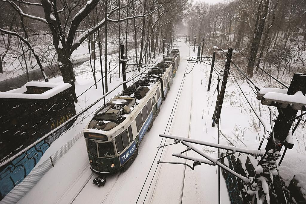 An MBTA green line subway train sits at a station during a winter snowstorm in Brookline, Massachusetts. (REUTERS/Brian Snyder)