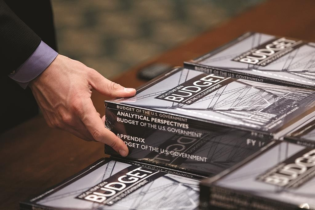 President Barack Obama's new $4 trillion budget plan is distributed by the Senate Budget Committee as it arrives on Capitol Hill in Washington, early Monday. (AP Photo/J. Scott Applewhite)