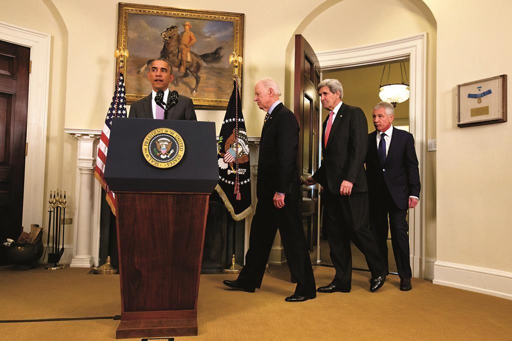 President Barack Obama, followed by Vice President Joe Biden, Secretary of State John Kerry and Defense Secretary Chuck Hagel, approaches the podium in the Roosevelt Room of the White House in Washington, Wednesday. (AP Photo/Jacquelyn Martin)