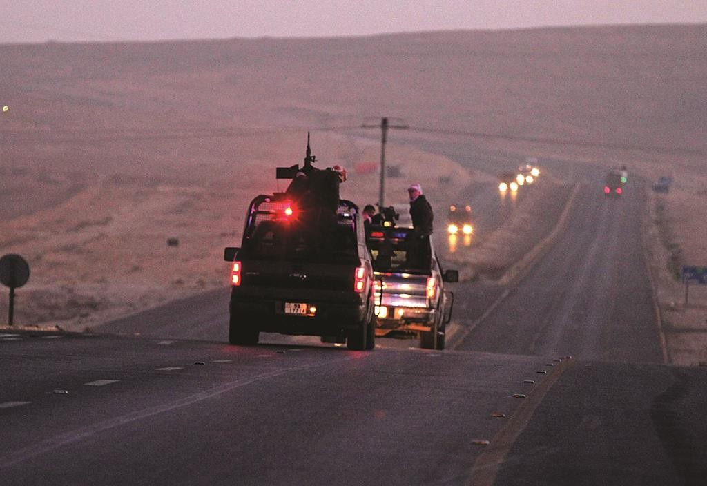 Jordanian security forces leave Swaqa prison after the executions of Sajida al-Rishawi and Ziad al-Karbouly, two Iraqis linked to al-Qaida, about 50 miles south of Jordan's capital, Amman, Wednesday. (AP Photo/Raad Adayleh)