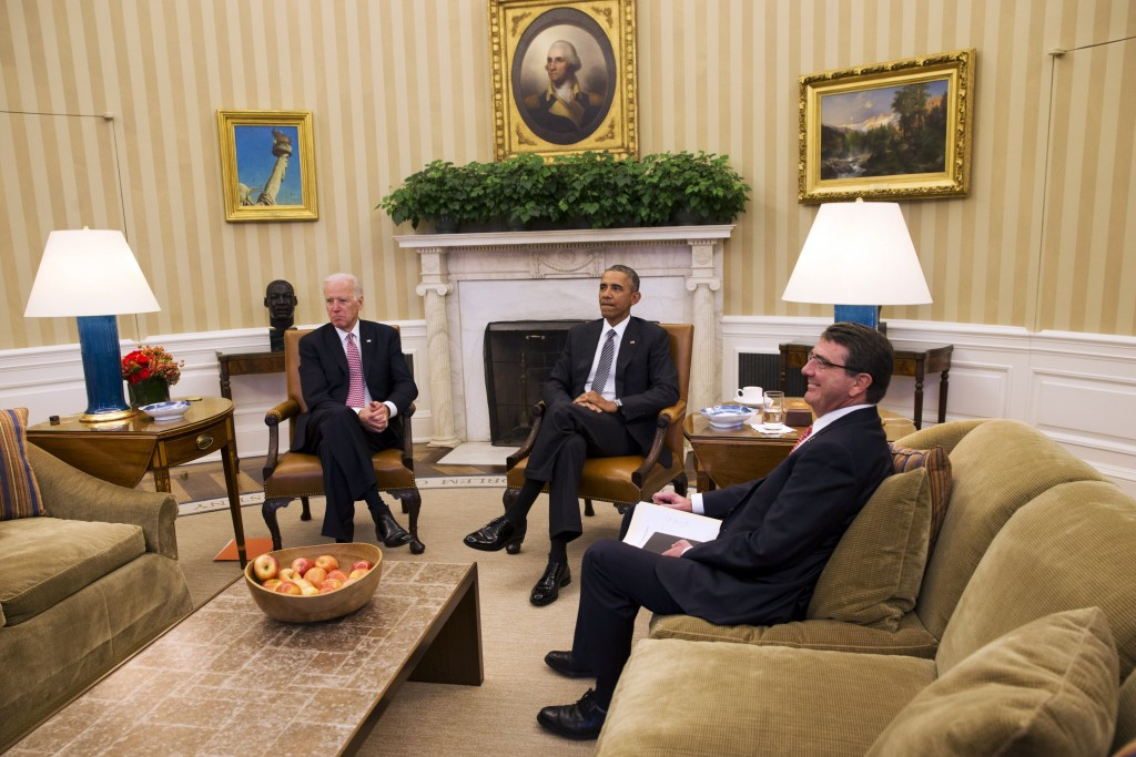 Vice President Joe Biden, left, and President Barack Obama meet with Secretary of Defense Ash Carter in the Oval Office of the White House on Tuesday, Feb. 17, 2015. At a media session, the president spoke about issues including immigration and ISIS. (AP Photo/Jacquelyn Martin)
