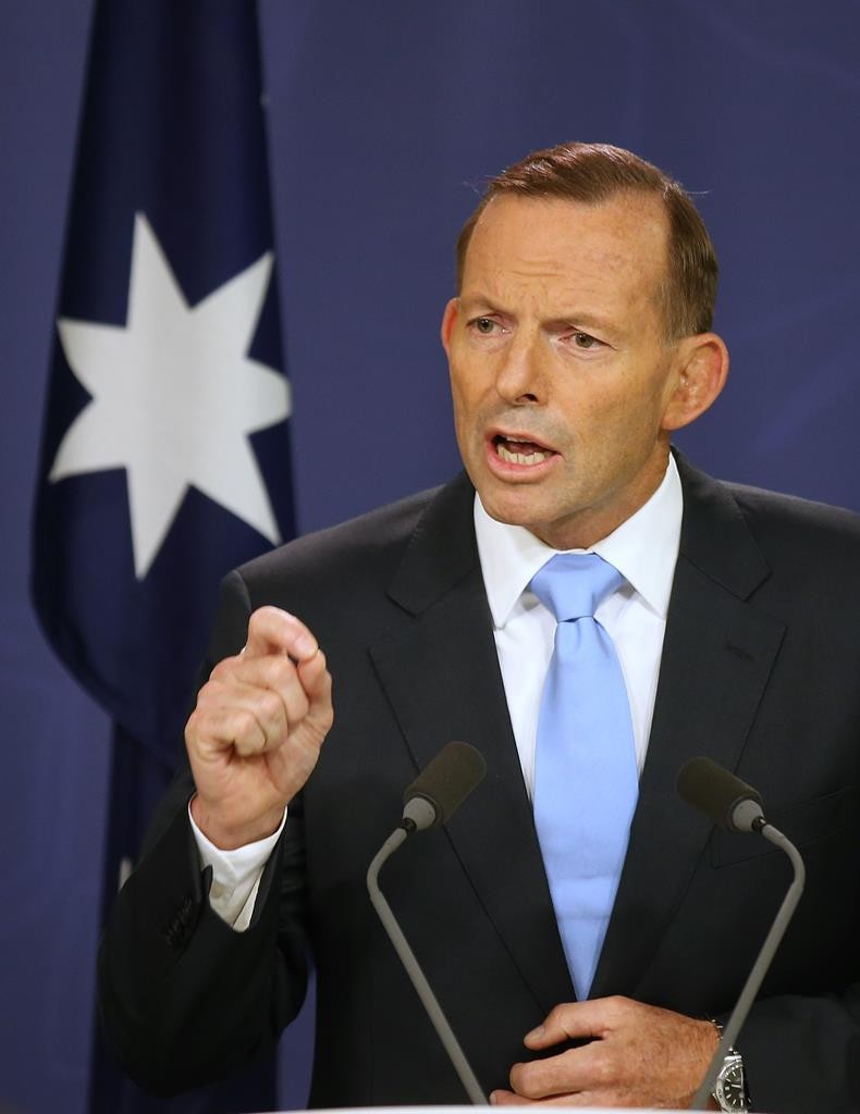 Australian Prime Minister Tony Abbott makes a statement at the government offices in Sydney, Australia, on Friday. (AP Photo/Rick Rycroft)