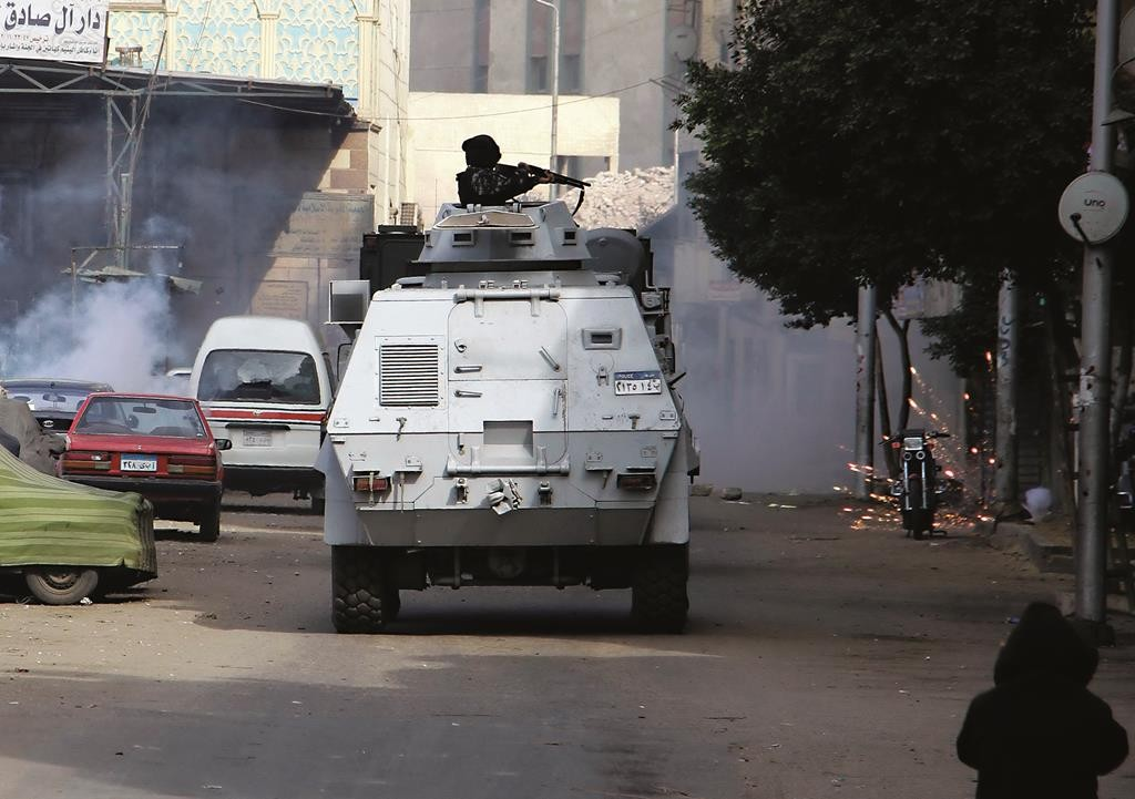 Egyptian security forces fire in the Cairo suburb of Matariyah, Egypt, Sunday. (AP Photo/Ahmed Abdel Fattah)