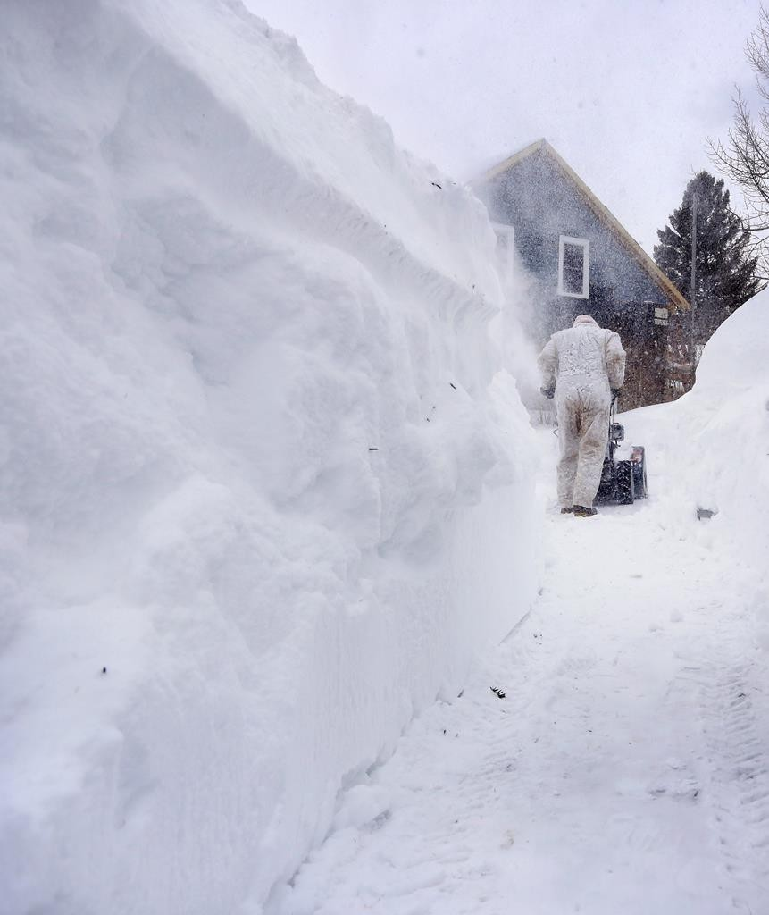 Bruce Williams clears a path in front of his home after a storm that left over a foot and a half of fresh snow in Kittery, Maine, Sunday. (AP Photo/Portland Press Herald, Derek Davis)